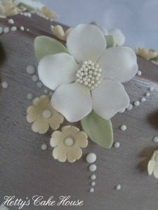 Close up silver blossom cake