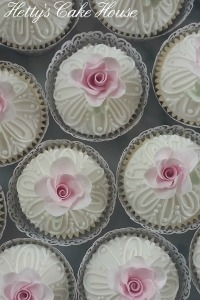 White piped domed with rose cupcake close up
