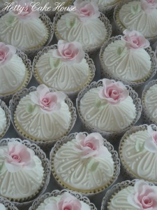 White piped with rose cupcakes
