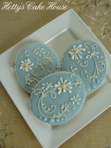 Daisy wedding cookies on plate