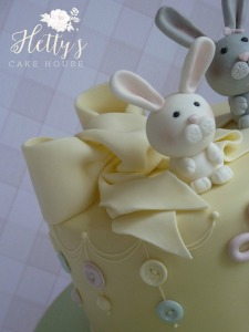 Bunny and bow christening cake