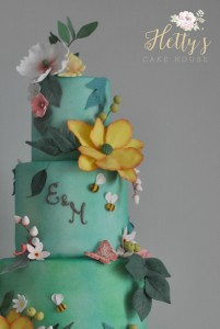 Wild Meadow wedding cake logo close up